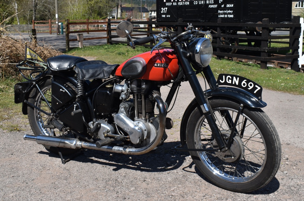 Photograph of a classic Ariel motorcycle in the sunshine