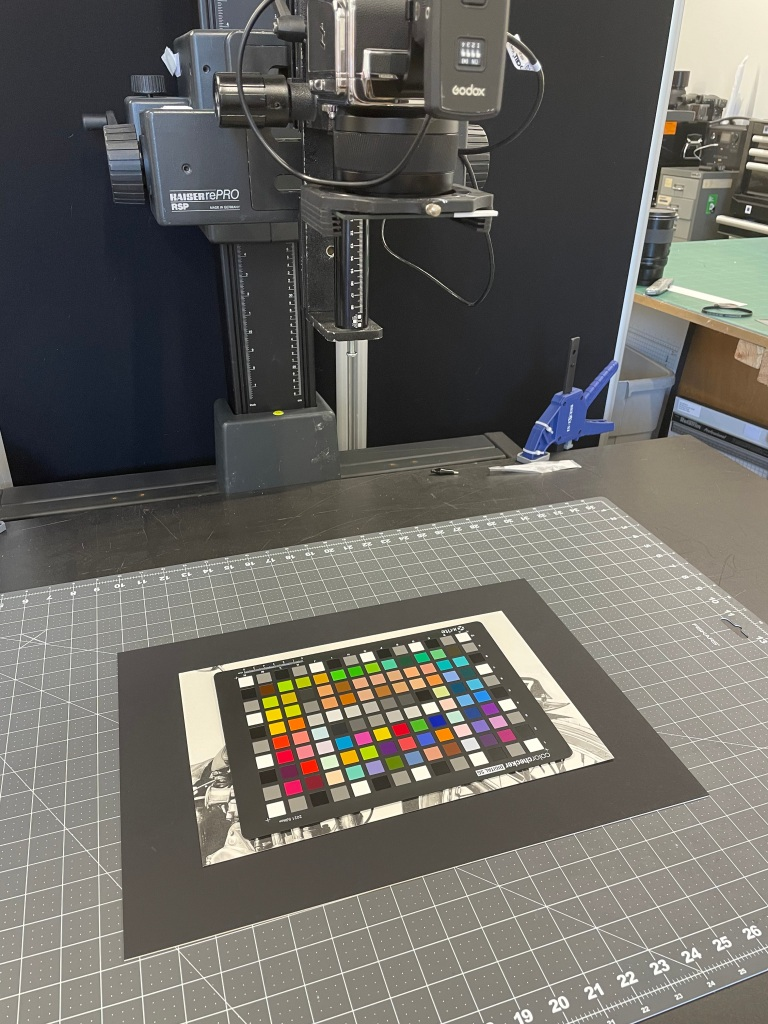 Motorcycle art being photographed with a color chart for Giclée printing